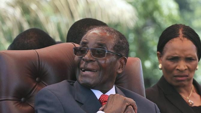 Zimbabwe's President Mugabe laughs before addressing the ZANU-PF party's top decision making body, the Politburo, in the capital Harare