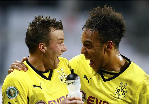 Borussia Dortmund's Aubameyang and Grosskreutz celebrate their victory over Eintracht Frankfurt after their German soccer cup (DFB Pokal) quarter-final soccer match in Frankfurt