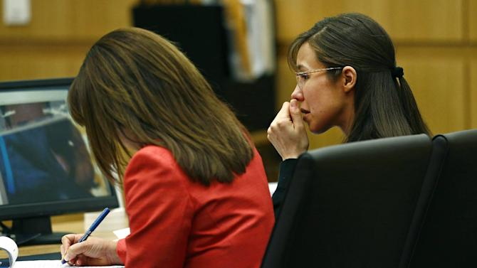 Defendant Jodi Arias, right, listens to defense attorney Kirk Nurmi make his closing arguments during her trial on Friday, May 3, 2013 at Maricopa County Superior Court in Phoenix.  Arias is charged with first-degree murder in the stabbing and shooting death of Travis Alexander, 30, in his suburban Phoenix home in June 2008. (AP Photo/The Arizona Republic, Rob Schumacher, Pool)