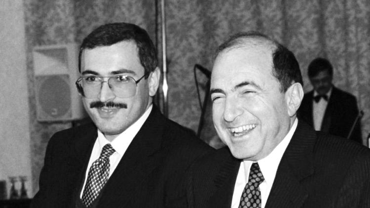 FILE -In this undated file photo, Boris Berezovsky, right, and Mikhail Khodarkovsky, two of Russia's most prominent tycoons, smile at a reception in Moscow. United Kingdom police have said that Berezovsky has been found dead Saturday March 23, 2013.(AP Photo/Alexei Kondratyev)
