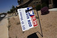 Real estate for sale and Housing and Urban Development (HUD) signs are displayed outside a home in Chandler Heights, Arizona June 2, 2011. REUTERS/Joshua Lott
