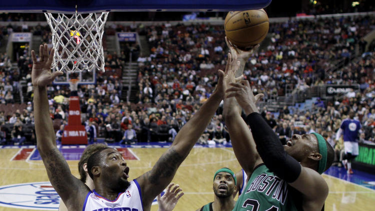 Boston Celtics' Paul Pierce, right, goes up for a shot as Philadelphia 76ers' Arnett Moultrie defends in the first half of an NBA basketball game, Friday, Dec. 7, 2012, in Philadelphia. (AP Photo/Matt Slocum)