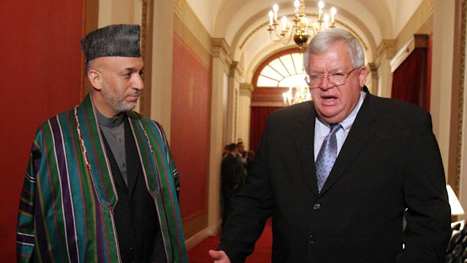 """FILE - In this Sept. 26, 2006 file photo, Afghan President Hamid Karzai, left, meets with House Speaker Dennis Hastert of Ill. on Capitol Hill in Washington.  A newly unveiled indictment against Hastert released Thursday, May 28, 2015,  accuses the Republican of agreeing to pay $3.5 million in hush money to keep a person from the town where he was a longtime schoolteacher silent about """"prior misconduct.""""  (AP Photo/Lauren Victoria Burke, File)"""