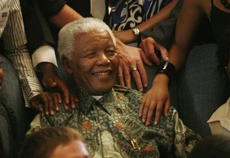Former President Mandela greets recipients of 2008 Mandela Rhodes scholarship at his offices in Johannesburg