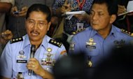National Search And Rescue Ageny Chief Vice Marshall TNI Daryatmo explains during a press conference in Jakarta.