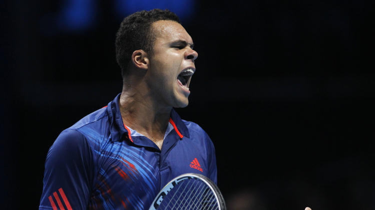 Jo-Wilfried Tsonga of France reacts to a point lost to Tomas Berdych of Czech Republic during their ATP World Tour Finals singles tennis match at the O2 Arena in London, Wednesday, Nov. 7, 2012. (AP Photo/Sang Tan)