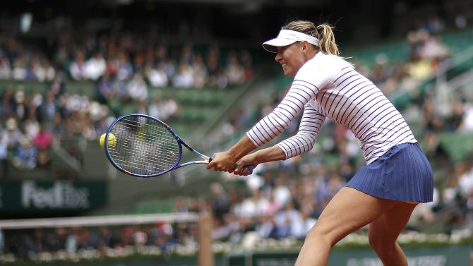 Maria Sharapova of Russia plays a shot to Samantha Stosur of Australia during their women's singles match at the French Open tennis tournament at the Roland Garros stadium in Paris