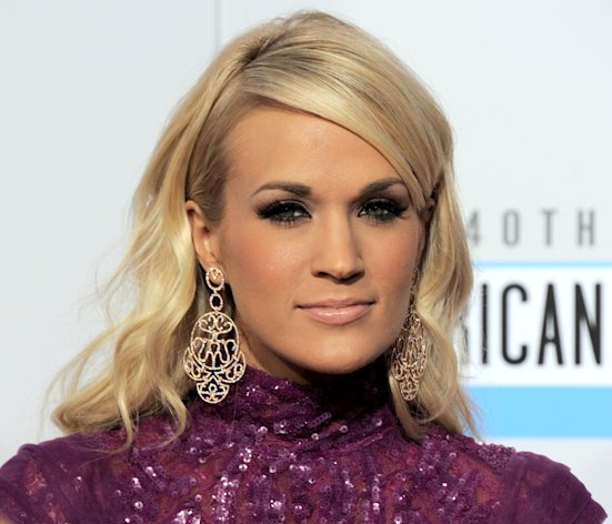 "FILE - In this Sunday, Nov. 18, 2012 file photo, Carrie Underwood arrives at the 40th Anniversary American Music Awards in Los Angeles. Underwood will star in NBC's live broadcast of ""The Sound of Music"" late next year, according to a news release Friday, Nov. 30, 2012. (Photo by Jordan Strauss/Invision/AP, File)"