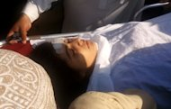 A wounded Pakistani girl, Malala Yousufzai, is moved to a helicopter to be taken to Peshawar for treatment in Mingora, Swat Valley, Pakistan on Tuesday, Oct. 9, 2012. A Taliban gunman walked up to a bus taking children home from school in Pakistans volatile Swat Valley Tuesday and shot and wounded a 14-year-old activist known for championing the education of girls and publicizing atrocities committed by the Taliban, officials said. (AP Photo/Sherin Zada)