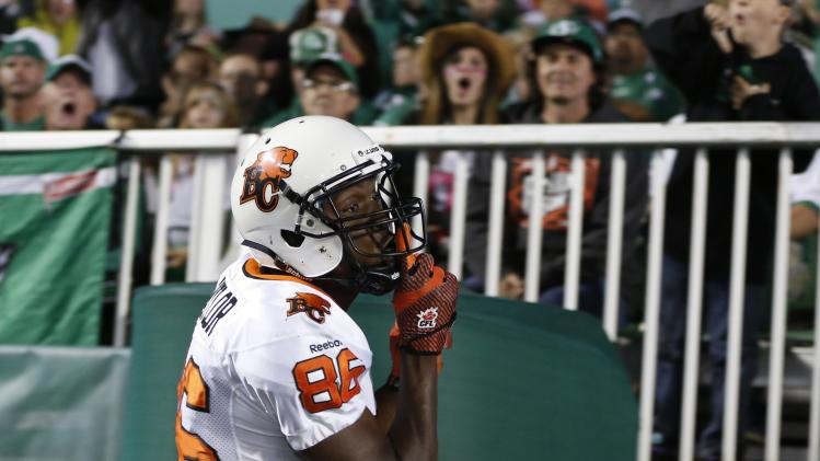 BC Lions' slotback Taylor taunts the Saskatchewan Roughriders fans after scoring his touchdown during their CFL football game in Regina