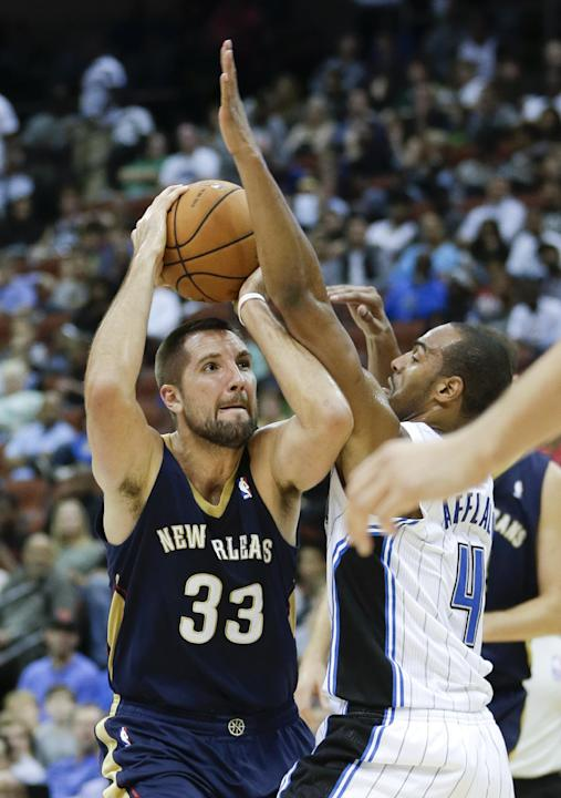 New Orleans Pelicans' Ryan Anderson (33) makes a move to the basket as he is guarded by Orlando Magic's Arron Afflalo (4) during the first half of an NBA preseason basketball game in Jacksonville, Fla