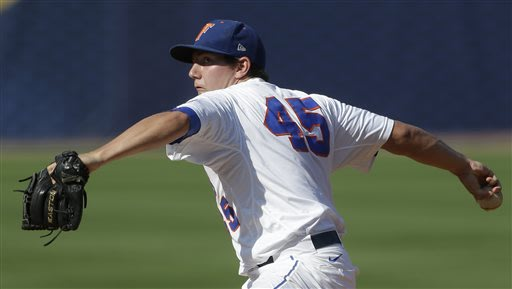 Florida's Johnny Magliozzi pitches in the first inning of a Southeastern Conference tournament college baseball game against Texas A&M at the Hoover Met in Hoover, Ala., Tuesday, May 21, 2013