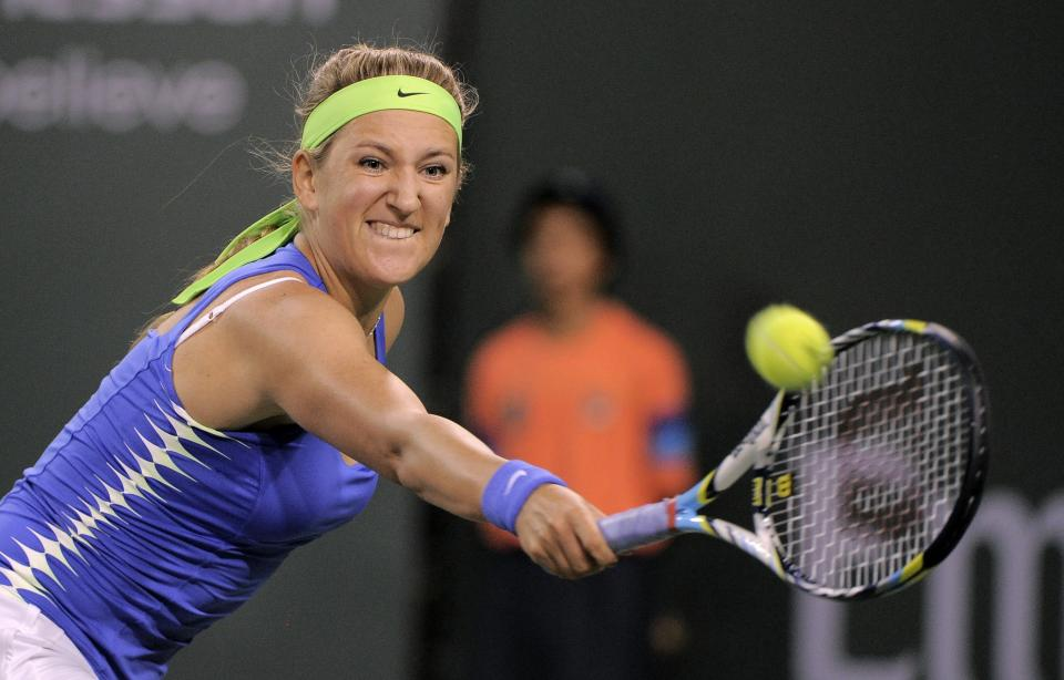 Victoria Azarenka, of Belarus, returns a shot to Angelique Kerber, of Germany, during their match at the BNP Paribas Open tennis tournament, Friday, March 16, 2012, in Indian Wells, Calif. (AP Photo/Mark J. Terrill)