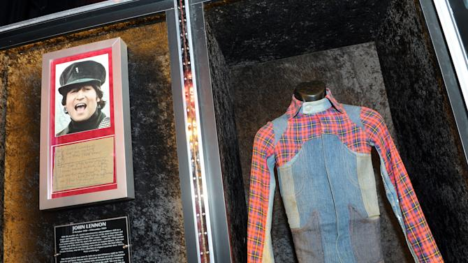 "A jacket worn by John Lennon and his lyrics to the song ""Help"" are displayed at the launch of Hard Rock International's traveling music memorabilia collection, ""Gone Too Soon,"" Wednesday, Feb. 13, 2013, at Hard Rock Cafe New York.   ""Gone Too Soon"" pays tribute to music icons whose lives and career where tragically cut short and will be on tour at Hard Rock locations in the U.S. throughout 2013. (Photo by Diane Bondareff/Invision for Hard Rock International/AP Images)"