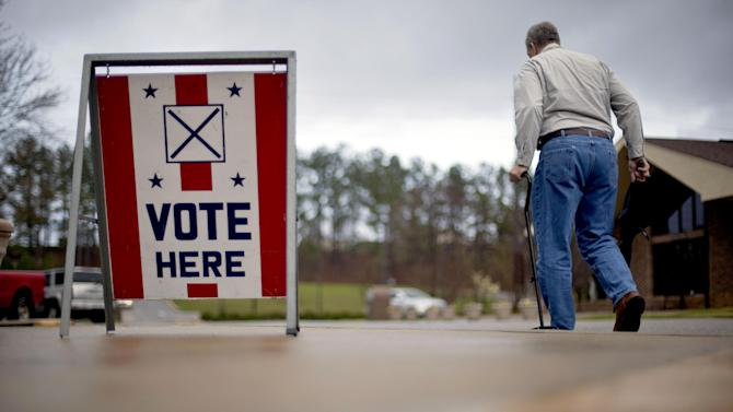 A voter leaves a polling place in Birmingham, Ala., Tuesday, March 13, 2012. Alabama voters would be deciding Tuesday whether Mitt Romney has deep South appeal, if it's time for Newt Gingrich to go forward or go home, and whether Rick Santorum can trim the Republican field. (AP Photo/David Goldman)