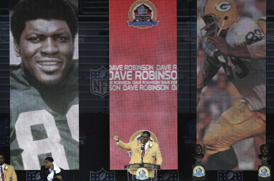 Former NFL football player Dave Robinson speaks during the induction ceremony at the Pro Football Hall of Fame Saturday, Aug. 3, 2013, in Canton, Ohio. (AP Photo/Tony Dejak)