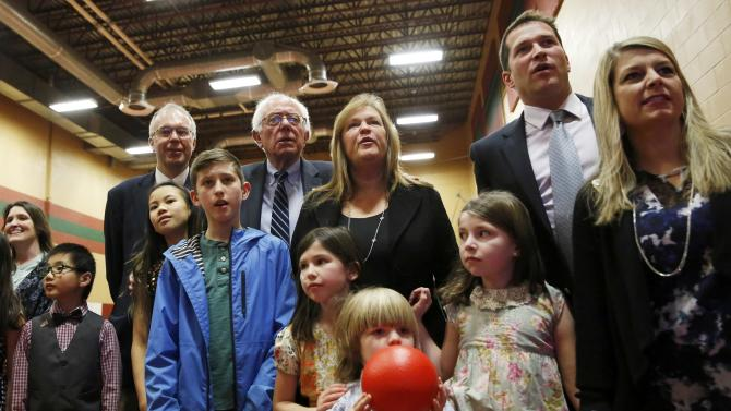 Democratic U.S. presidential candidate Bernie Sanders and his wife Jane Sanders watch returns with their family at his 2016 New Hampshire presidential primary night rally in Concord