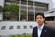 Yubari Mayor Naomichi Suzuki poses in front of city hall in Yubari in Japan&#39;s northern island of Hokkaido. Of those who are left in Yubari, 45 percent are aged 65 or over -- high even by the standards of greying Japan -- putting extra strain on medical and social welfare services, while adding little to the tax take
