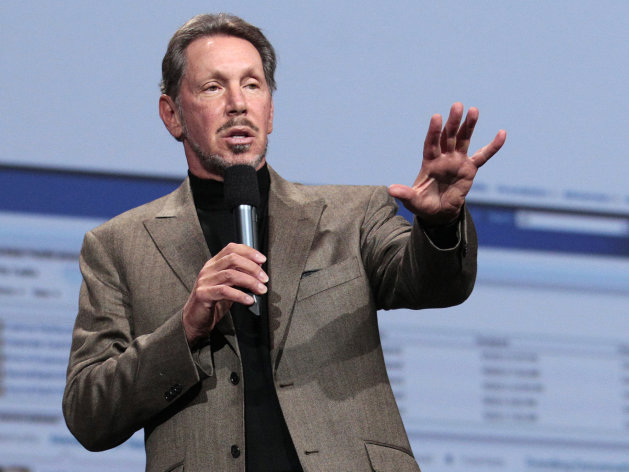 In this Oct. 5, 2011 photo, Oracle CEO Larry Ellison speaks during the Oracle OpenWorld Keynote in San Francisco. The 3,200 people living on a rural Hawaiian island that will soon be purchased by Ellison have a laundry list of what they'd like to see him provide. Working-class residents on Lanai want stable jobs. Affordable housing. No onerous restrictions on hunting or fishing. A return to agriculture. Improved transportation to Maui, Oahu and other islands given an airport with limited flights. Even simple things like the reopening of the community pool. They hope he's willing to sit down, listen to their concerns and be sensitive to the unique culture of Hawaii. (AP Photo/Jeff Chiu)