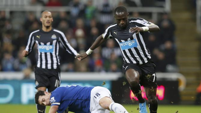 Everton's Gareth Barry is challenged by Newcastle United's Moussa Sissoko during their English Premier League soccer match at St James' Park in Newcastle