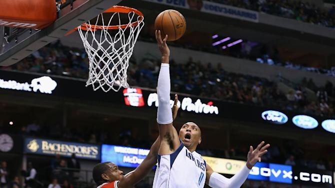 Mavs beat Bucks 106-93 without Nowitzki, Carlisle