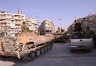 Syrian army tanks patrol a residential neighhourhood in the northern Syrian city of Aleppo on September 8. Meanwhile in Damascus, an explosion rocked the upscale western district of Mazzeh overnight, while pro-regime gunmen clashed with rebels in Barzeh, another wealthy neighbourhood in the northeast, the Observatory said