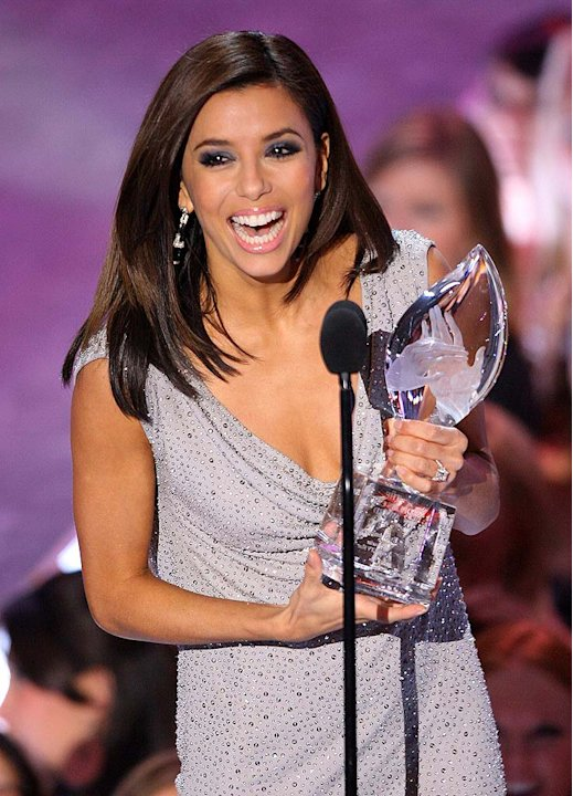 Eva Longoria celebrates winning Favorite Female TV Star at The 33rd Annual People's Choice Awards.
