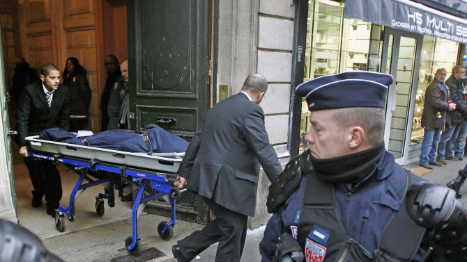 One of the three bodies of the killed Kurdish women is taken out of the building in Paris, Thursday Jan. 10, 2012. Police say three Kurdish women have been shot dead at a pro-Kurdish centre in Paris in what the French interior minister is calling an execution. (AP Photo/Remy de la Mauviniere)