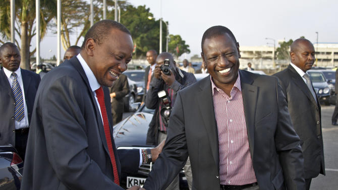 In this photo released by Kenya's Presidency, Kenyan President Uhuru Kenyatta, left, shares a light moment with Deputy President William Ruto, right, shortly before departing to attend the African Union (AU) Heads of State special summit in Addis Ababa, Ethiopia, at the airport in Nairobi, Kenya Saturday, Oct. 12, 2013. African heads of state and government are meeting at the AU headquarters in Ethiopia to deliberate the continent's relationship with the International Criminal Court in The Hague, where the two men face crimes against humanity charges for Kenya's 2007-08 post-election violence in which more than 1,000 people died. (AP Photo/Kenya Presidency)