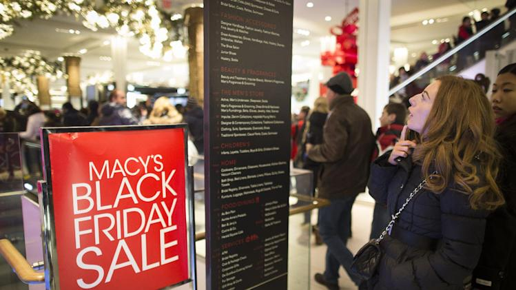 A shopper reads a store layout board at the Macy's Herald Square flagship store, Thursday, Nov. 28, 2013, in New York. Instead of waiting for Black Friday, which is typically the year's biggest shopping day, more than a dozen major retailers are opening on Thanksgiving this year. (AP Photo/John Minchillo)