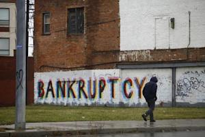A man walk past graffiti in Detroit