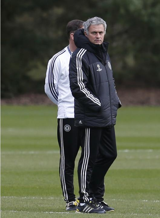 Chelsea manager Mourinho watches a team training session at their training ground in Cobham, southern England