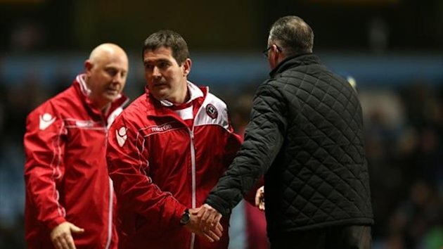 Sheffield United's manager Nigel Clough, left with Aston Villa's manager Paul Lambert at the end of the match (PA Photos)
