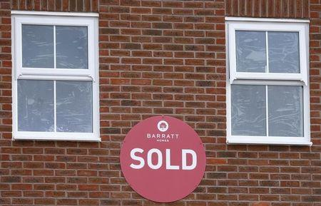 A sold sign hangs on a new house on a Barratt Homes building site in Nuneaton