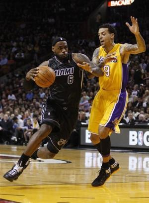 Even ailing, James leads Heat past Lakers 98-87