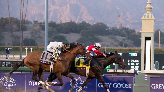Fort Larned, with Brian Hernandez atop, crosses the finish line ahead of Mucho Macho Man with Mike Smith atop to win the running of the Breeders' Cup Classic horse race, Saturday, Nov. 3, 2012, at Santa Anita Park in Arcadia, Calif. (AP Photo/Julie Jacobson)