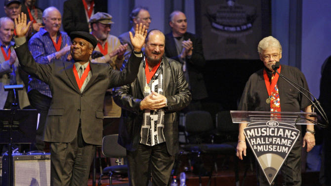 "FILE - In this Oct. 28, 2008 file photo, Booker T. Jones, left, Steve Cropper, center, and Donald ""Duck"" Dunn, right, of the group Booker T. & the MGs, acknowledge the applause as they are inducted into the Musicians Hall of Fame in Nashville, Tenn. Bass player and songwriter Dunn died in Tokyo, Sunday May 13, 2012. He was 70. (AP Photo/Mark Humphrey, File)"