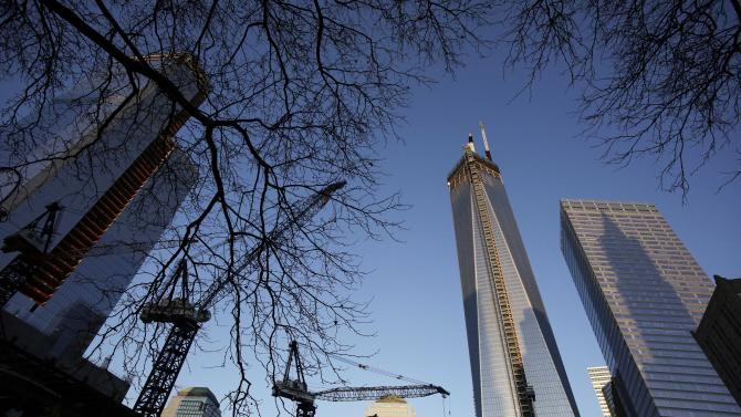 One World Trade Center, right, towers above construction cranes working at the site, Monday, Feb. 25, 2013 in New York. Tuesday will mark the 20th anniversary of the terrorist bombing beneath the World Trade Center that killed six people. (AP Photo/Mark Lennihan)