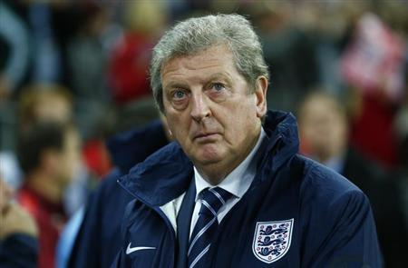 Roy Hodgson watches his team before the start of their 2014 World Cup ...