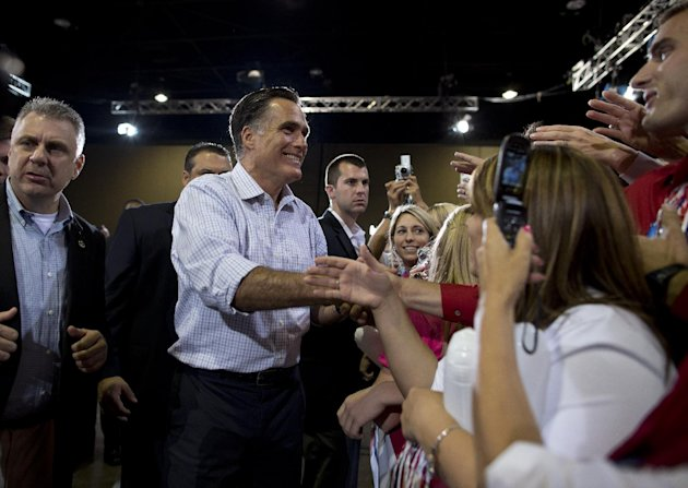 Republican presidential candidate, former Massachusetts Gov. Mitt Romney shakes hands during a campaign rally on Wednesday, Sept. 26, 2012 in Toledo, Ohio. (AP Photo/ Evan Vucci)