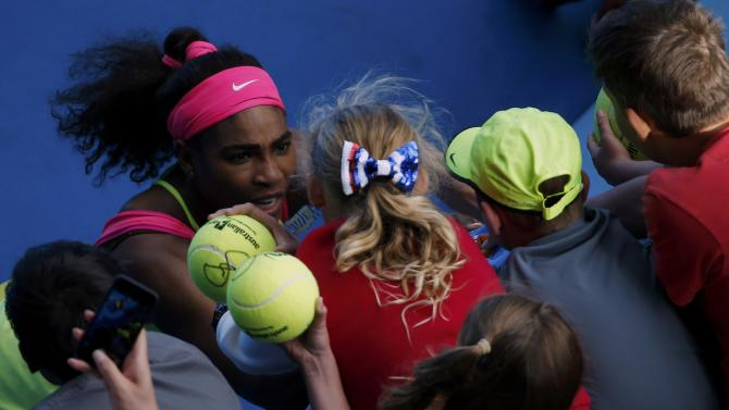 Williams of the U.S. signs autographs after defeating Muguruza of Spain in their women's singles fourth round match at the Australian Open 2015 tennis tournament in Melbourne