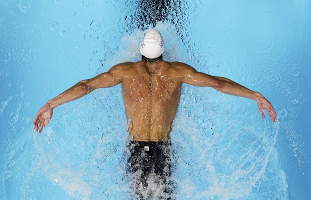 Michael Phelps swims in a men's 200-meter butterfly semifinal at the U.S. Olympic swimming trials, Wednesday, June 27, 2012, in Omaha, Neb. (AP Photo/Nati Harnik)
