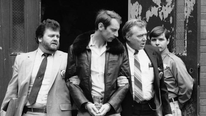 "FILE - In this Wednesday, Jan. 16, 1985 file photo, Bernhard Goetz, second from left, is escorted by police as he is taken out of criminal court in New York. Police say Goetz, 65, was nabbed in a sting operation in Union Square on Friday afternoon, Nov. 1, 2013 selling $30 worth of marijuana to an undercover officer. The ""subway vigilante"" who shot four panhandling youths on a train in 1984 was cleared of attempted murder charges but convicted of weapons charges and spent 250 days in jail. (AP Photo/Rene Perez)"