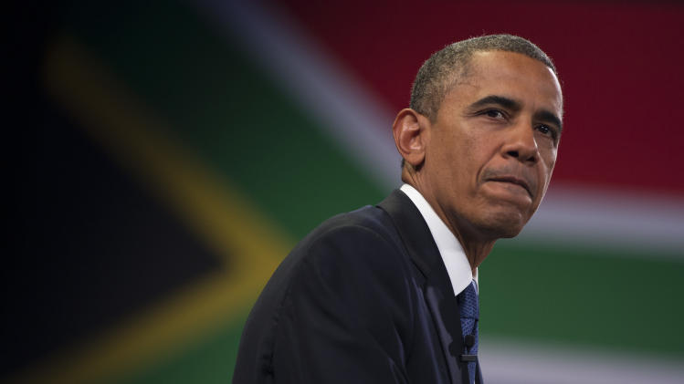 U.S. President Barack Obama pauses during a town hall meeting with young African leaders at the University of Johannesburg Soweto on Saturday, June 29, 2013, in Johannesburg, South Africa. The president is in South Africa, embarking on the second leg of his three-country African journey. The visit comes at a poignant time, with former South African president and anti-apartheid hero Nelson Mandela ailing in a Johannesburg hospital. (AP Photo/Evan Vucci)