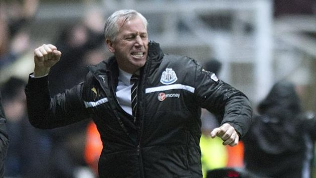Newcastle United's manager Alan Pardew celebrates after his side take the lead against QPR on December 22
