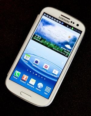 FILE - This June 19, 2012 file photo shows Samsung's new Galaxy S III phone, in New York. Millions of cell phones that use Google's Android operating system — including the popular Samsung Galaxy S III — are vulnerable to a digital bug that can disable the devices or wipe them clean of their data, including their contacts, music, photos and more. The security researcher who discovered the flaw urged consumers on Friday to update their phone software soon to protect themselves. (AP Photo/Bebeto Matthews)