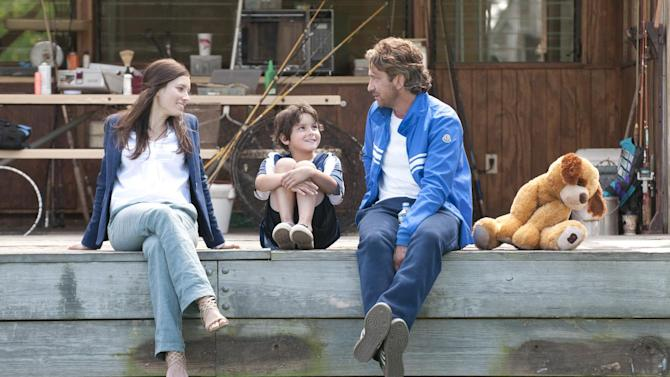"""This film image released by FilmDistrict shows, from left, Jessica Biel, Noah Lomax, and Gerard Butler in a scene from """"Playing for Keeps."""" (AP Photo/FilmDistrict, Dale Robinette)"""