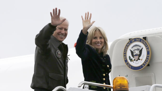 Vice President Joe Biden, accompanied by his wife Jill Biden, wave as they board Air Force Two at O'Hare International Airport in Chicago, Wednesday, Nov. 7, 2012, a day after President Barack Obama winning a second term. (AP Photo/Matt Rourke)
