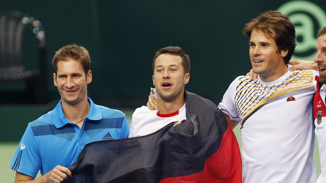Germany's Florian Mayer, Philipp Kohlschreiber and Tommy Haas, from left, celebrate during a Davis Cup World Group first round tennis match between Germany and Spain in Frankfurt, Germany, Saturday, Feb. 1, 2014. Germany has now a 3-0 lead and advances to the next round. (AP Photo/Michael Probst)