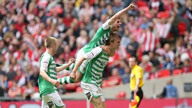 Dan Burn, bottom right, scored Yeovil's second goal when on loan there last season as they won promotion to the Championship (PA Photos)